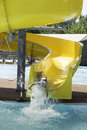 Children slide down a water slide sunny day Stock Images