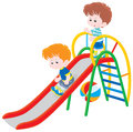 Children on a slide little boys sliding down playground Royalty Free Stock Photography