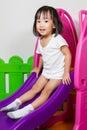 Children sliding asian chiense girl at indoor playground Royalty Free Stock Photo