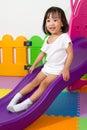 Children sliding asian chiense girl at indoor playground Stock Photo