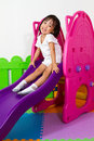 Children sliding asian chiense girl at indoor playground Royalty Free Stock Photos