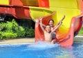 Children sliding down a water slide Royalty Free Stock Photo