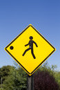 Children slow down road sign caution advising to because playing ball Stock Photography