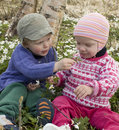 Children smelling the flowers Royalty Free Stock Photo