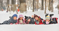 Children in the snow in winter group of playing on time Stock Image