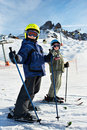Children on the snowy ski slopes Royalty Free Stock Images