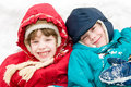 Children at snowy winter outdoors Stock Images