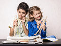Children studying in art class boy and girl paint using wooden dummies at painting tools on the table Stock Image