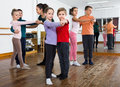 Children studying of partner dance at dance school Royalty Free Stock Photo