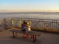 Children in sunset sitting at port navalo brittany france Stock Image