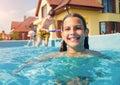 Children swim outdoors kids in swimming pool girl Stock Images
