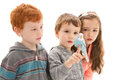 Children with tame pet budgerigar three sitting on hand isolated on white Royalty Free Stock Photography
