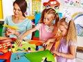 Children with teacher at classroom happy Stock Photos