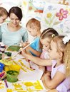 Children with teacher painting happy Royalty Free Stock Photos