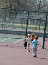 Children at a tennis court Stock Image