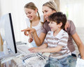 Children and their mother using a computer Stock Photography