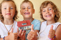 Children together keeping in hands model of house Royalty Free Stock Photo