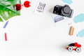 Children tourism outfit with toys and camera on white background flat lay mockup