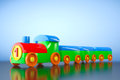 Children toy multicolor plastic train d rendering on a blue background Royalty Free Stock Images