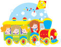 Children travel by train little girls and boys riding on a toy Royalty Free Stock Images