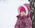 Children at the tree girl in winter forest Stock Images