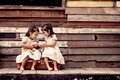 Children two cute asian little girls are sitting on suitcase Royalty Free Stock Photo