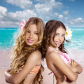 Children two friends girls happy in tropical beach vacation together vintage color Royalty Free Stock Images