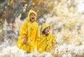 Children under the autumn rain