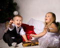 Children unpack gifts Royalty Free Stock Images