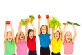 Children with vegetables group of little girls holding Royalty Free Stock Photography