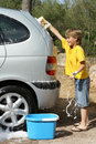 children washing car Royalty Free Stock Photo