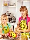Children washing fruit at kitchen happy Royalty Free Stock Image