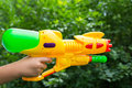 Children water gun in children s hand a Stock Photo