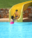 Children at water slide Royalty Free Stock Photo