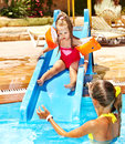 Children on water slide at aquapark. Royalty Free Stock Photo