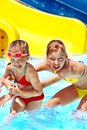 Children water slide aquapark summer holiday Royalty Free Stock Photo