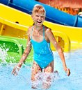 Children on water slide at aquapark summer holiday Royalty Free Stock Photos