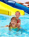 Children on water slide at aquapark summer holiday Royalty Free Stock Photography