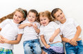 Children in white shirts lying on the floor isolated background Royalty Free Stock Image