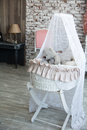 Children wicker cradle with teddy bears Royalty Free Stock Photo