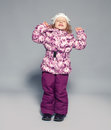 Children in winter clothes kids down jackets fashion child Royalty Free Stock Photo