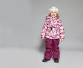 Children in winter clothes kids down jackets fashion child Royalty Free Stock Photos