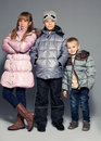 Children in winter clothes kids down jackets fashion child Royalty Free Stock Image