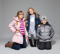 Children in winter clothes kids down jackets fashion child Stock Images