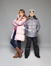 Children in winter clothes kids down jackets fashion child Stock Photos