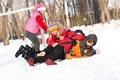 Children in winter park fooled in the snow actively spending time outdoors Royalty Free Stock Images