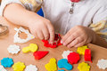 Children work with plasticine hands of a child make figurines of modeling clay Royalty Free Stock Photo