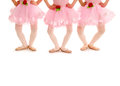 Childrens ballet legs in demi plie three small girls recital costume and slippers practice Royalty Free Stock Images