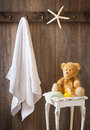 Childrens bathroom with hanging white towel and teddy bear Stock Photography