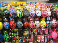 Childrens bicycle safety helmets children s colorful in a shop display this display is in the halfords store situated in bedford Stock Photography
